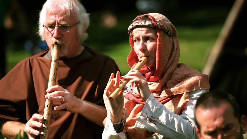 The Yardarm Folk Orchestra perform at a community event in Priory park